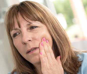 Image of a Lady suffering from bad tooth pain